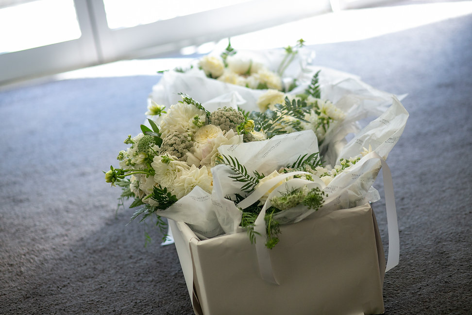 Wedding flowers including bride's bouquet and brides maids bouquet at Gibraltar Hotel, Bowral. Wedding photography by best sydney wedding photographer, Grant Hoskinson Photography.