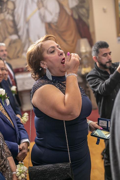 Traditional wedding ceremony celebration during Egyptian Coptic wedding ceremony. St Mary and St Merkorious Coptic Orthodox church. Photography by best Sydney wedding photographer Grant Hoskinson Photography.