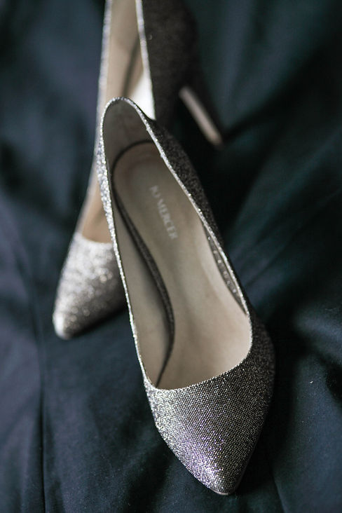 Beautiful wedding photography by popular wedding photographer, Grant Hoskinson Photography. Bride's wedding shoes.