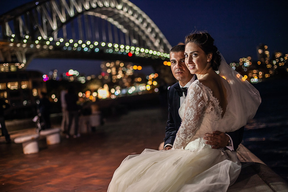 Bride and groom at passenger terminal, Sydney with Sydney Harbour bridge in the background. Wedding photography by best sydney wedding photographer, Grant Hoskinson Photography.