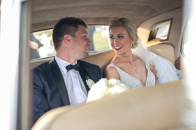 After the ceremony. Bride and groom inside the car about to drive off. Bride and groom at the wedding ceremony at HMAS Watson Chapel. Wedding photography by best Sydney wedding photographer, Grant Hoskinson Photography.