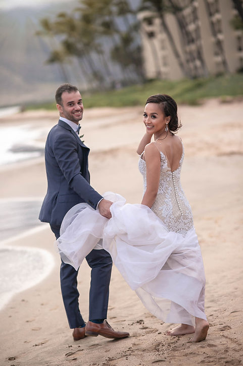 Bride and Groom on the beach in Maui, Hawaii for their destination wedding. Photography by Best Sydney wedding photographer Grant Hoskinson Photography.