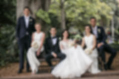 Bride and groom with bridal party in Hye Park, Sydney. Wedding photgraphy by Sydney wedding photographer Grant Hoskinson Photography.