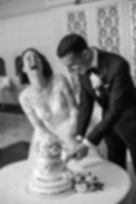 Bride and groom cutting cake. Wedding reception. QVB Tea Room. Wedding photgraphy by Sydney wedding photographer Grant Hoskinson Photography.