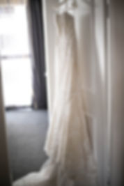 Beautiful wedding photography by best sydney wedding photographer, Grant Hoskinson Photography. Wedding dress hanging on the door.