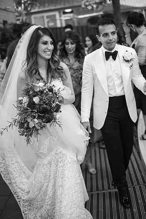 Bride and groom leaving church.  St Mary and St Merkorious Coptic Orthodox church. Photography by best Sydney wedding photographer Grant Hoskinson Photography.