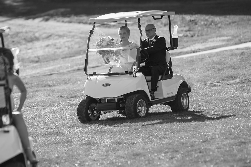 Bride and father of the bride arriving in a golf buggy to the ceremony site at Gibraltar Hotel, Bowral. Wedding photography by best sydney wedding photographer, Grant Hoskinson Photography.
