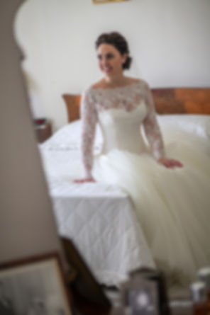Bride getting ready and sitting on the bed. Wedding photography by best sydney wedding photographer, Grant Hoskinson Photography.
