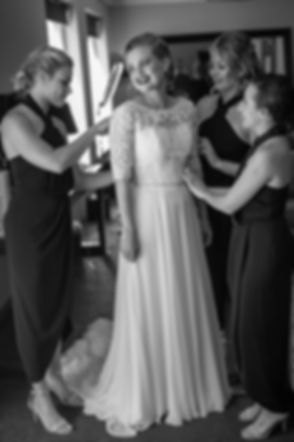 Bridesmaids helping the bride get ready Gibraltar Hotel, Bowral. Wedding photography by best sydney wedding photographer, Grant Hoskinson Photography.