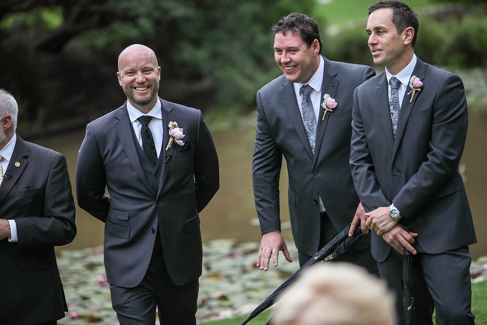 Beautiful wedding photography by popular wedding photographer, Grant Hoskinson Photography. Groom watching the bride walking down the aisle to the wedding ceremony.Groom with groomsmen.  Royal Botanic Gardens, Melbourne.