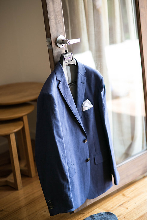 Grooms suit hanging on the doorknob. Photography by Sydney wedding photographer, Grant Hoskinson Photography.