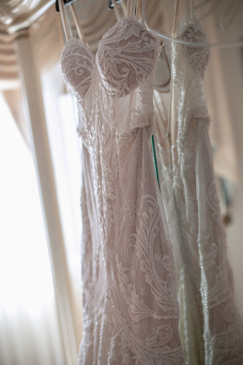 Bride's wedding dress hanging. Photography by best Sydney wedding photographer Grant Hoskinson Photography.