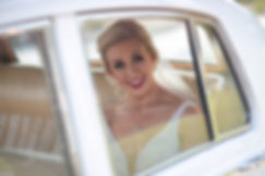 Emotional bride in the wedding car arriving for the wedding ceremony at HMAS Watson Chapel. Wedding photography by best Sydney wedding photographer, Grant Hoskinson Photography.