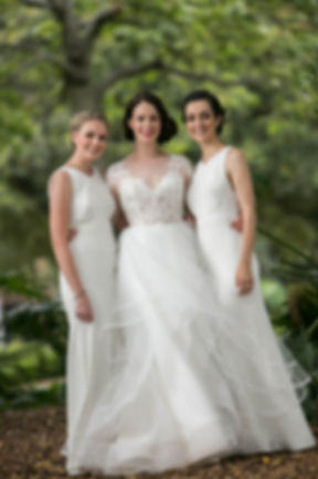 Bride with the bridesmaids in Hyde Park, Sydney. Wedding photgraphy by Sydney wedding photographer Grant Hoskinson Photography.