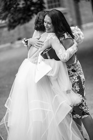Mother of the bride hugs her daughter, the bride. Wedding photgraphy by Sydney wedding photographer Grant Hoskinson Photography.