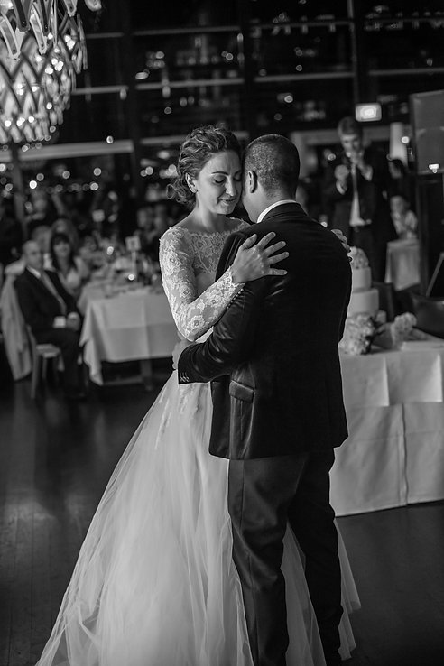 The bridal waltz, first dance at the wedding reception venue at Quay Restaurant. Wedding photography by best sydney wedding photographer, Grant Hoskinson Photography.
