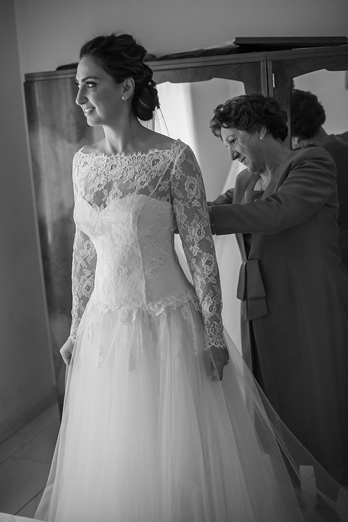 Mother of the bride helping dress the bride. Wedding photography by best sydney wedding photographer, Grant Hoskinson Photography.