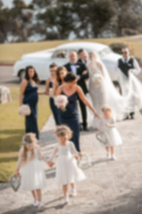Bride arriving for the wedding ceremony at HMAS Watson Chapel. Wedding photography by best Sydney wedding photographer, Grant Hoskinson Photography.