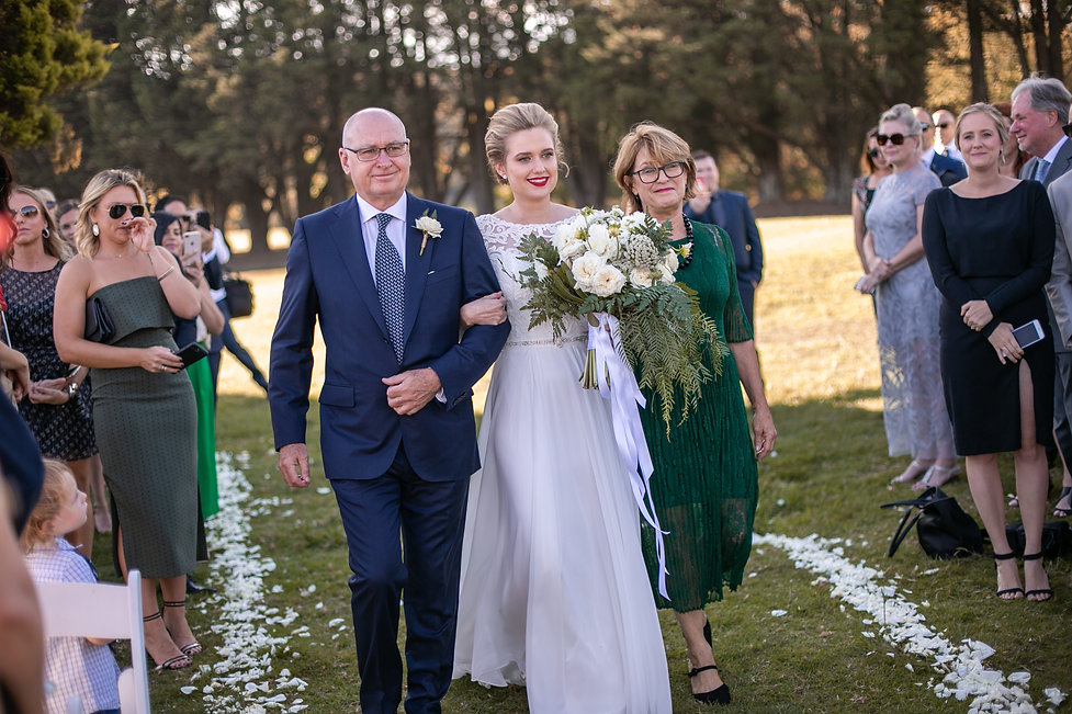 Parents of the bride walking the bride down the aisle at the ceremony at at Gibraltar Hotel, Bowral. Wedding photography by best sydney wedding photographer, Grant Hoskinson Photography.