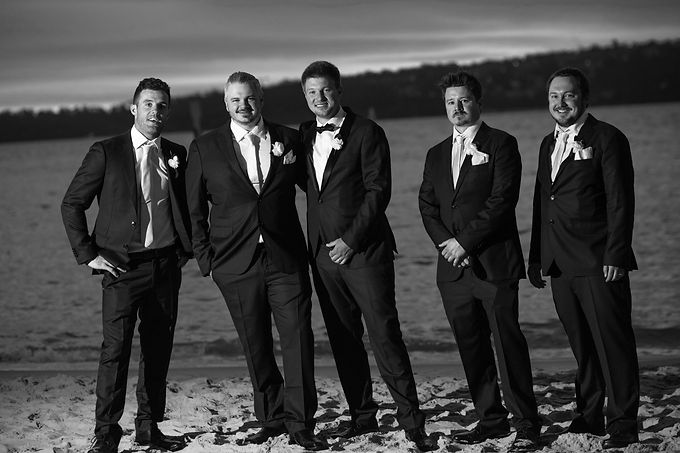 Groom and groomsmen and bridal party on location photos at Camp Cove, Sydney Harbour. Wedding photography by best sydney wedding photographer, Grant Hoskinson Photography.