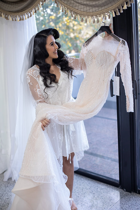 Bride with her Steven Khalil dress. Bride's shoes by Valentino. Bride's bouquet by Sydney wedding flowers. Wedding photography by best Sydney wedding photographer, Grant Hoskinson Photography. Bride's gown by Steven Khalil. Wedding Reception at Doltone House Jones Bay Wharf.