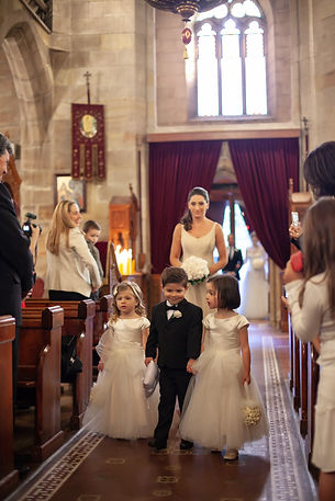 Flower girls and pageboy at the Cathedral of the Annunciation of Our Lady Greek church, Redfern, Sydney. Wedding photography by best sydney wedding photographer, Grant Hoskinson Photography.