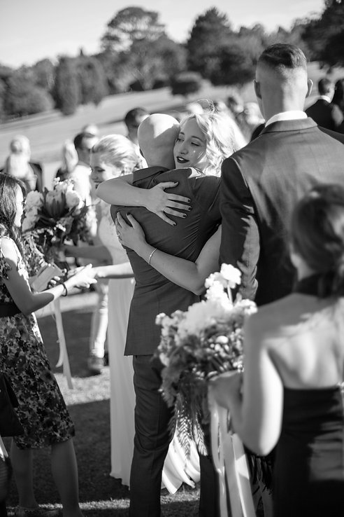 Mingling with guests after the outdoor wedding ceremony at Gibraltar Hotel, Bowral. Wedding photography by best sydney wedding photographer, Grant Hoskinson Photography.