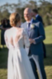 Bride and groom during outdoor wedding ceremony at Gibraltar Hotel, Bowral. Wedding photography by best sydney wedding photographer, Grant Hoskinson Photography.