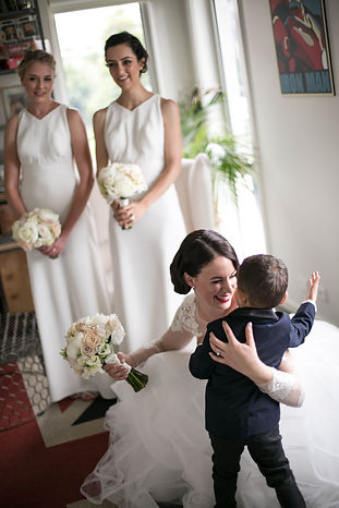 Bride giving the pageboy a hug. Wedding photgraphy by Sydney wedding photographer Grant Hoskinson Photography.