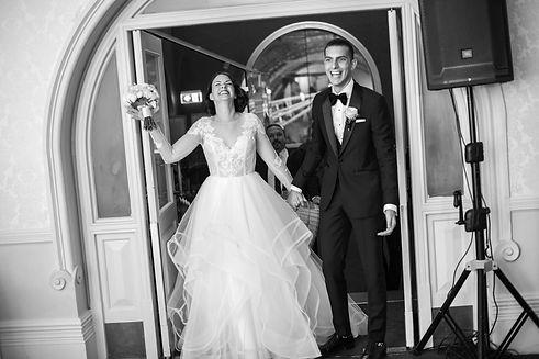 Bride and groom entering wedding reception. Wedding reception. QVB Tea Room. Wedding photgraphy by Sydney wedding photographer Grant Hoskinson Photography.