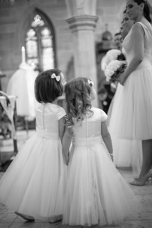 Flower girls at Greek wedding ceremony at the Cathedral of the Annunciation of Our Lady Greek church, Redfern, Sydney. Wedding photography by best sydney wedding photographer, Grant Hoskinson Photography.