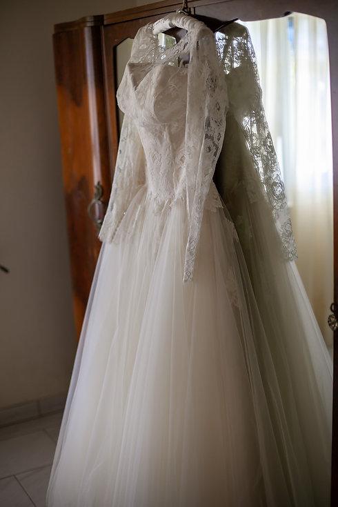 Wedding dress hanging. Wedding photography by best sydney wedding photographer, Grant Hoskinson Photography.