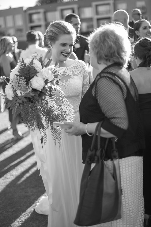 Mingling with wedding guests after the outdoor wedding ceremony at Gibraltar Hotel, Bowral. Wedding photography by best sydney wedding photographer, Grant Hoskinson Photography.