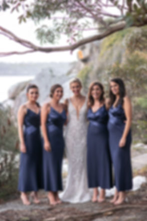 Bride and bridesmaids on location photos at Camp Cove, Sydney Harbour. Wedding photography by best sydney wedding photographer, Grant Hoskinson Photography.