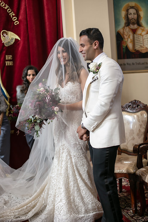Bride and groom during the Egyptian Coptic wedding ceremony. St Mary and St Merkorious Coptic Orthodox church. Photography by best Sydney wedding photographer Grant Hoskinson Photography.