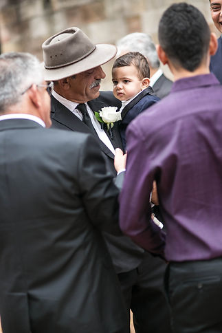 Father of the groom with the page boy. Wedding photgraphy by Sydney wedding photographer Grant Hoskinson Photography.