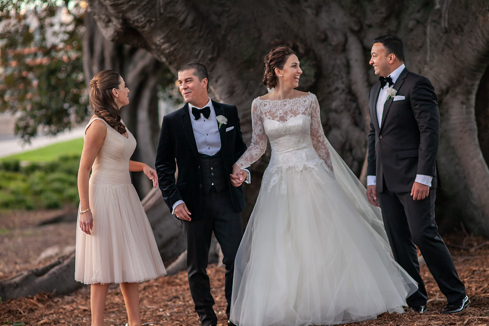 Bride and groom with bridal party during location photos at Centennial Park. Wedding photography by best sydney wedding photographer, Grant Hoskinson Photography.