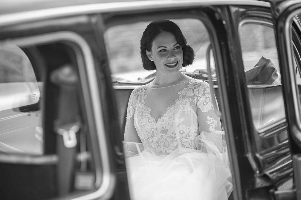Bride in the bridal car. Wedding photography by best sydney wedding photographer, Grant Hoskinson Photography.