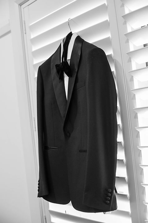 Groom's jacket and tie hanging. Wedding photgraphy by Sydney wedding photographer Grant Hoskinson Photography.