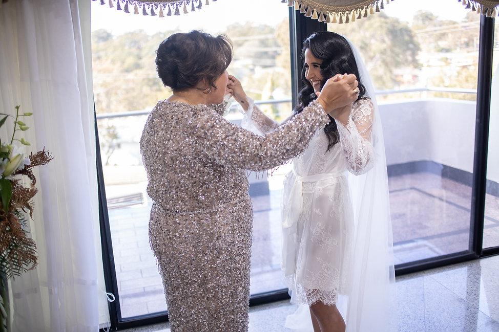 Bride with mother of the bride.Bride's shoes by Valentino. Bride's bouquet by Sydney wedding flowers. Wedding photography by best Sydney wedding photographer, Grant Hoskinson Photography. Bride's gown by Steven Khalil. Wedding Reception at Doltone House Jones Bay Wharf.