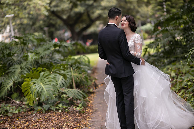 Bride and groom during wedding location photos at Hyde Park, Sydney. Wedding photography by best sydney wedding photographer, Grant Hoskinson Photography.