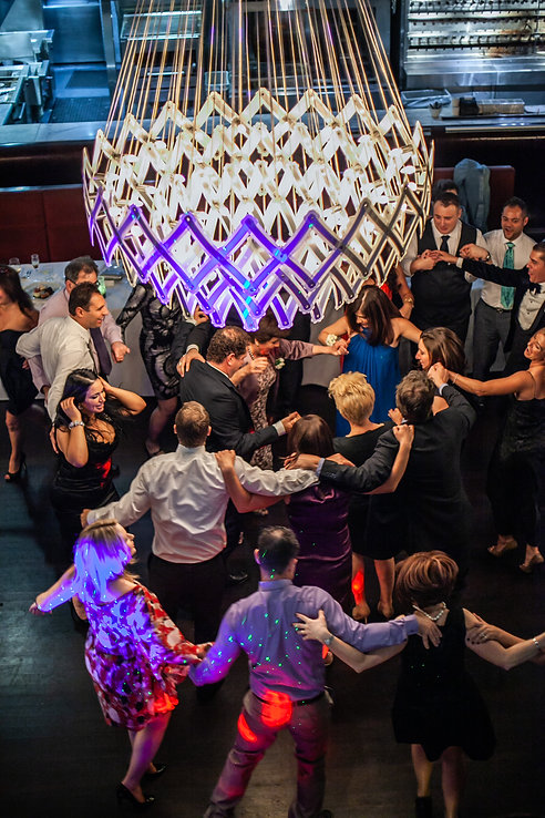 Traditional Greek dancing at the wedding reception venue at Quay Restaurant. Wedding photography by best sydney wedding photographer, Grant Hoskinson Photography.
