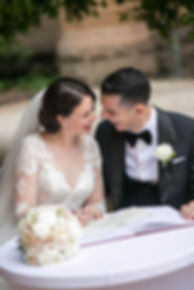 Bride and groom signing the marriage certificate after wedding ceremony at Hyde Park Barracks. Wedding photgraphy by Sydney wedding photographer Grant Hoskinson Photography.
