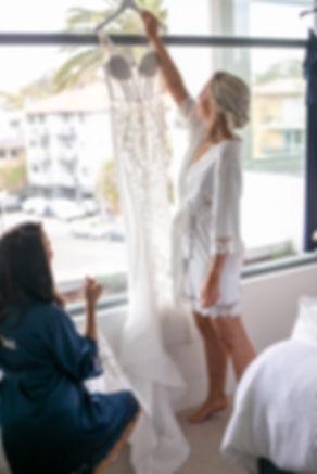 Bride with her wedding dress. Wedding photography by best sydney wedding photographer, Grant Hoskinson Photography.