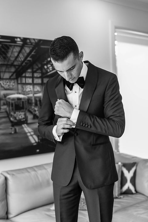 Groom putting on his cuff links. Wedding photography by best sydney wedding photographer, Grant Hoskinson Photography.