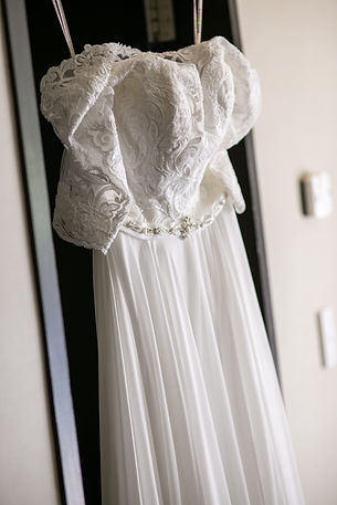 Bride's dress hanging at Gibraltar Hotel, Bowral. Wedding photography by best sydney wedding photographer, Grant Hoskinson Photography.