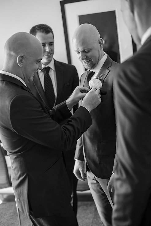Grooms buttonhole going on by best man at Gibraltar Hotel, Bowral. Wedding photography by best sydney wedding photographer, Grant Hoskinson Photography.
