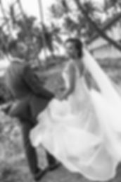 Bride and groom with palm trees. Maui Hawaii.