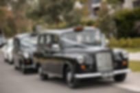 Old fashioned London cabs used as wedding cars. Wedding photography by best sydney wedding photographer, Grant Hoskinson Photography.
