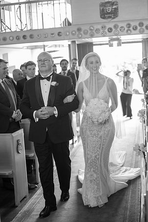 Bride walking down the aisle for the wedding ceremony at HMAS Watson Chapel. Wedding photography by best Sydney wedding photographer, Grant Hoskinson Photography.